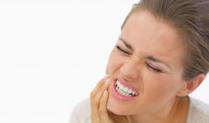 What are the main causes of tooth sensitivity?